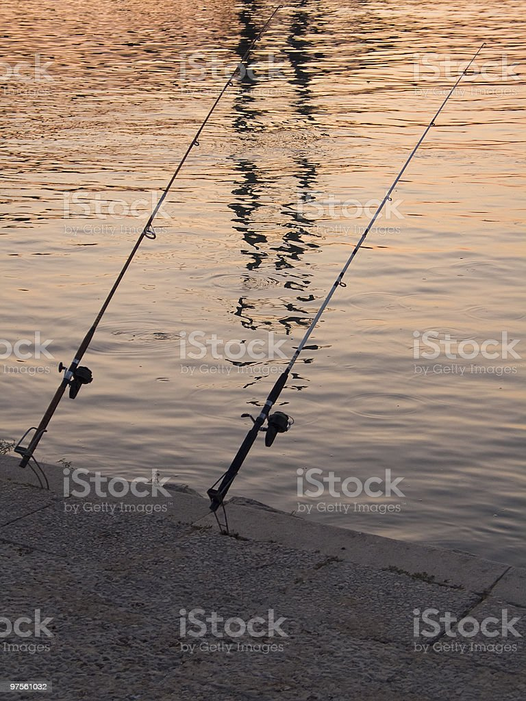 Two fishing rods royalty-free stock photo