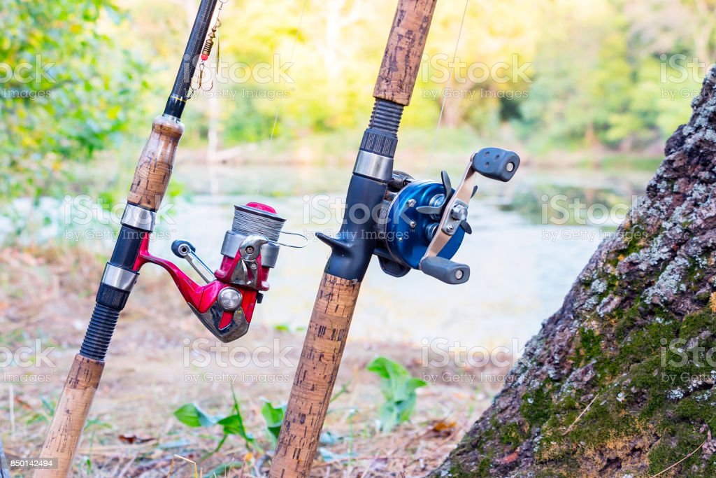 Two fishing rods with reels stock photo