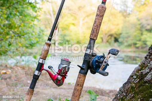 1094918172 istock photo Two fishing rods with reels 854067752
