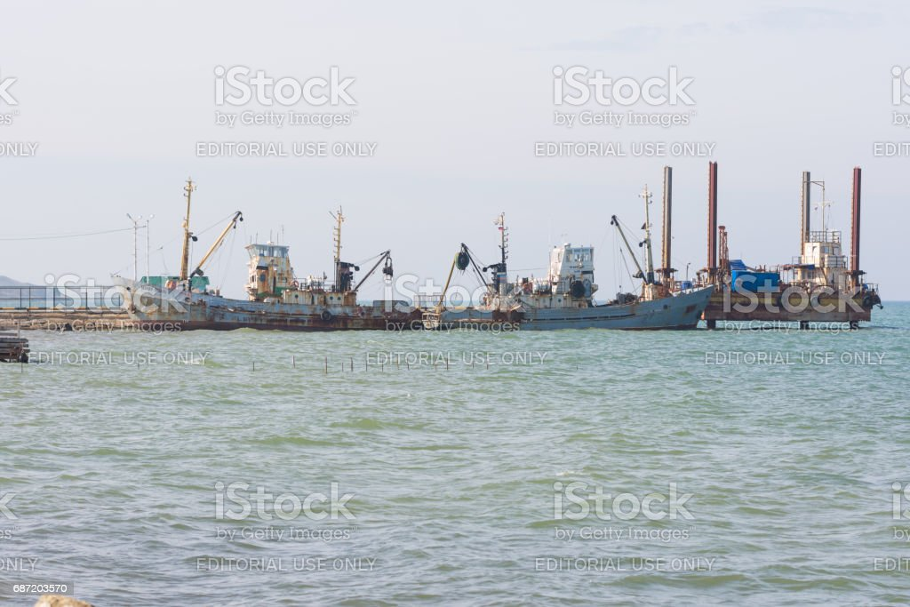 Taman, Russia - March 8, 2016: two fishing trawlers are berthed stock photo