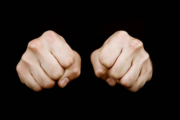 two fists - knuckle stock photos and pictures