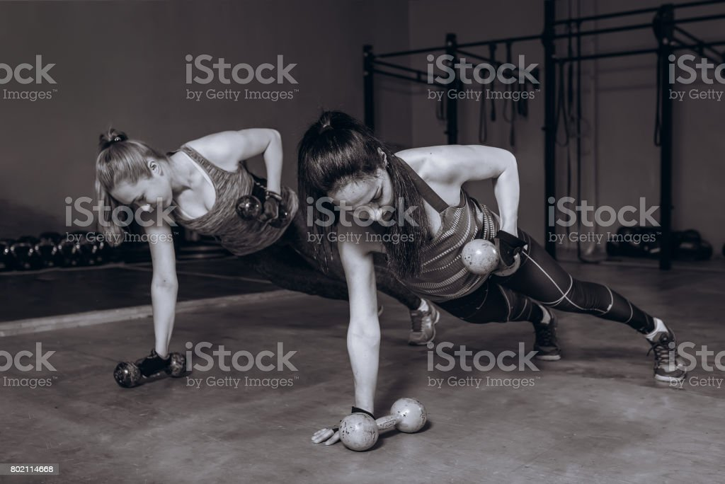 Two Fit Women In Gym Doing Fitness Exercises With Dumbbells Staying In Plank Pose Black And White Stock Photo Download Image Now Istock Our website is dedicated to beautiful female feet. two fit women in gym doing fitness exercises with dumbbells staying in plank pose black and white stock photo download image now istock