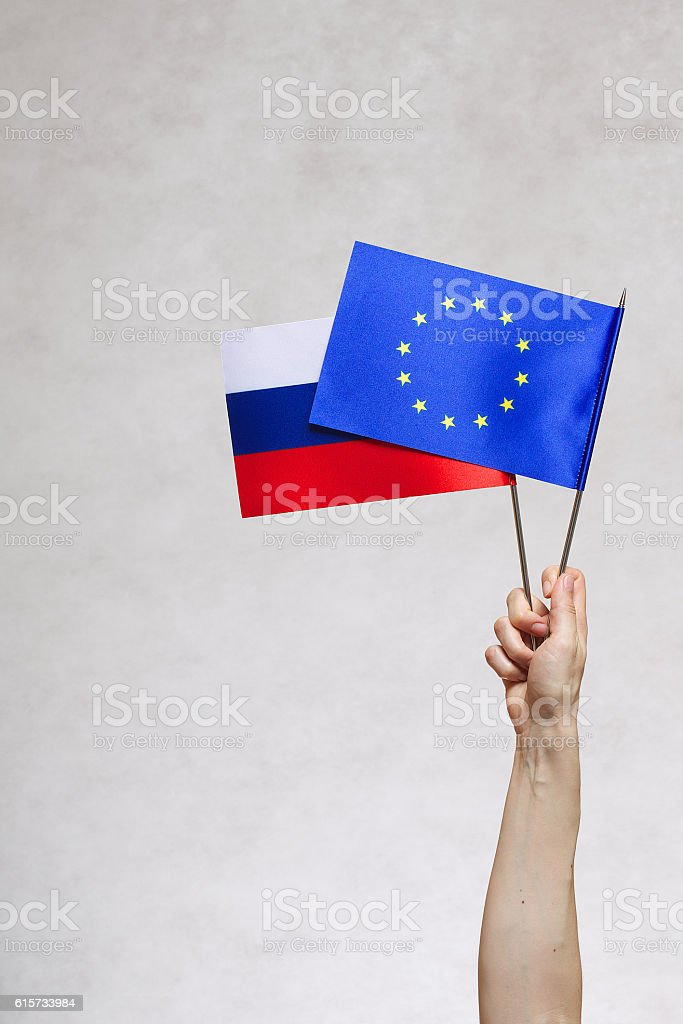 Two flags  EU and Russia stock photo