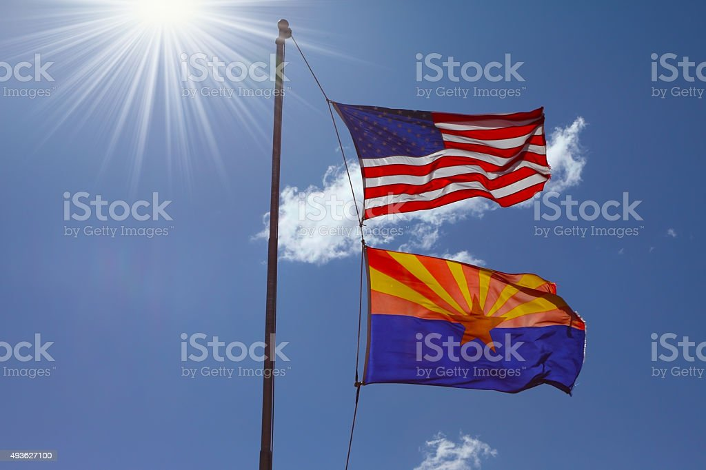 Two flags on a mast stock photo