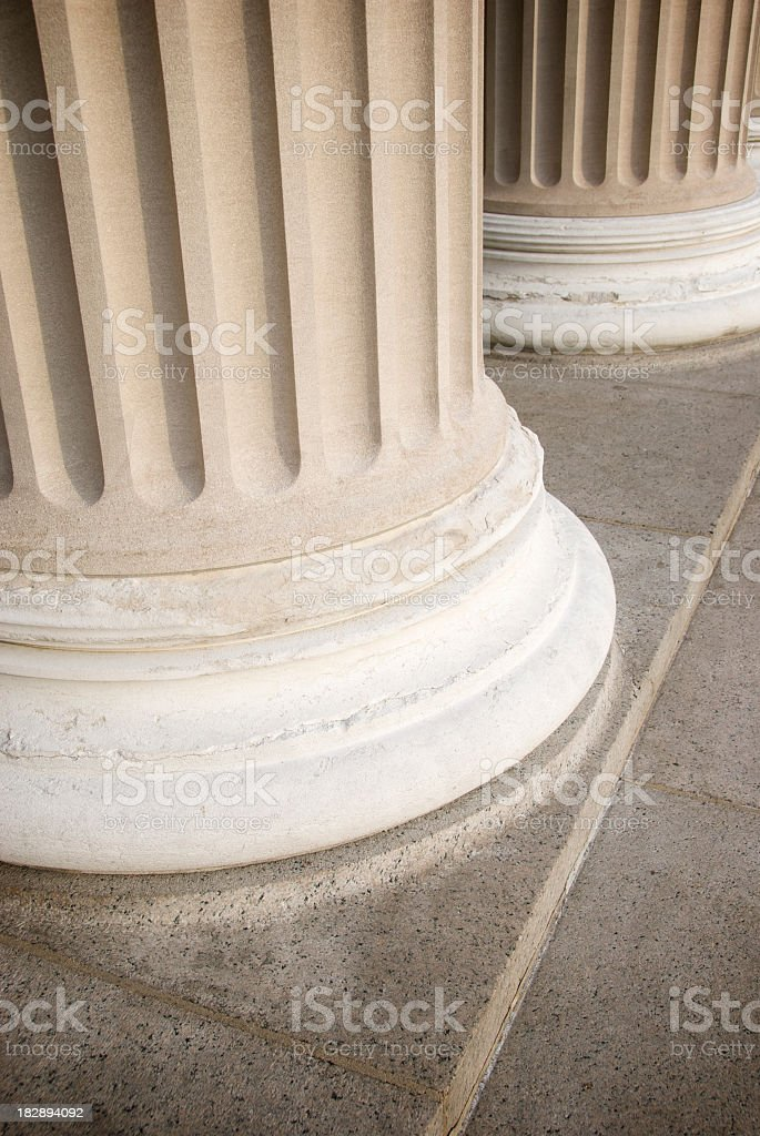 Two Fluted Columns with Stone Floor Copy Space stock photo