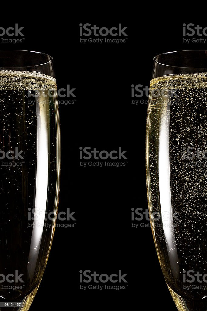 Two Flutes on Black Background royalty-free stock photo