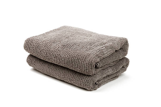 Two folded gray towels stacked together stock photo