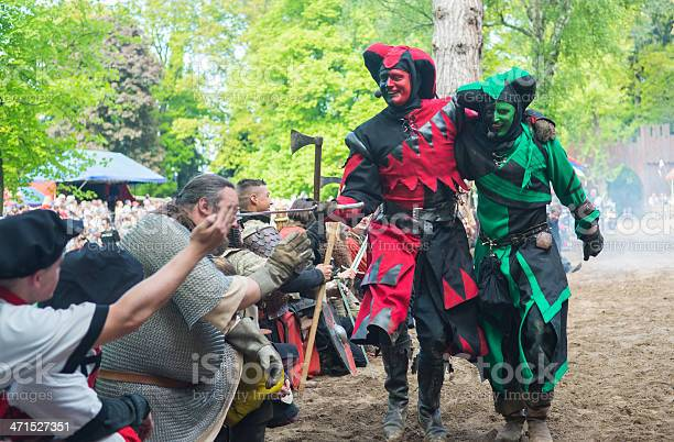 Satzvey, Germany - May 19, 2013: Two fools are laughing after the show is over (Medieval festival in Satzvey)