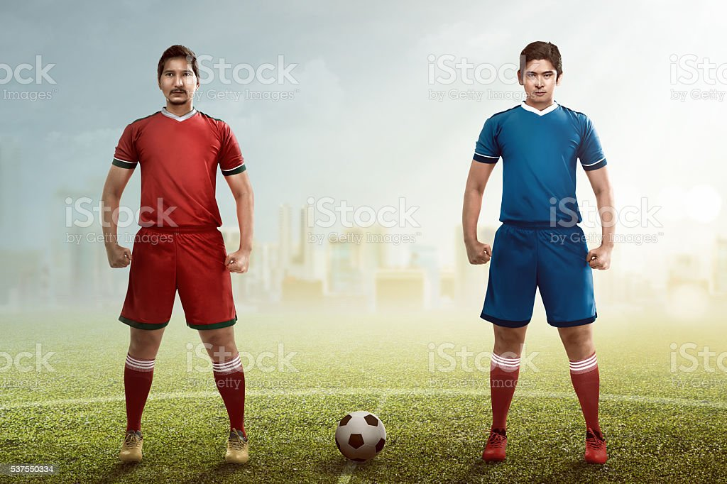 Two football player posing on the kickoff stock photo
