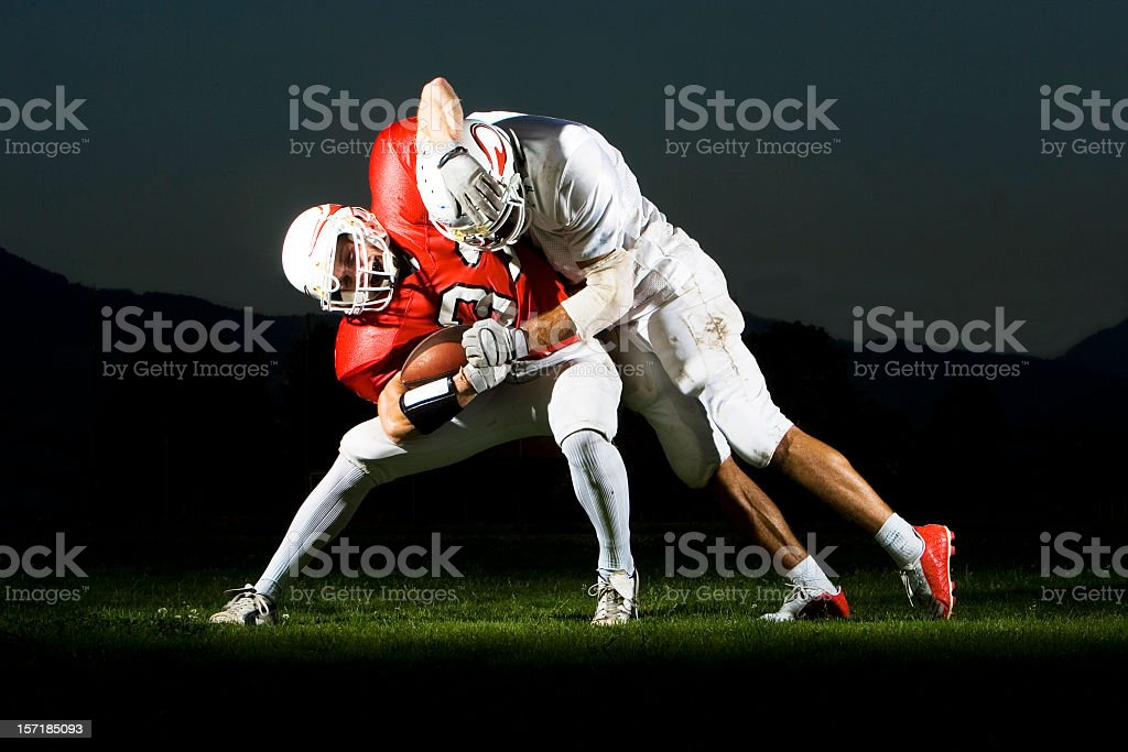 Two Football Players Fighting for the Ball stock photo