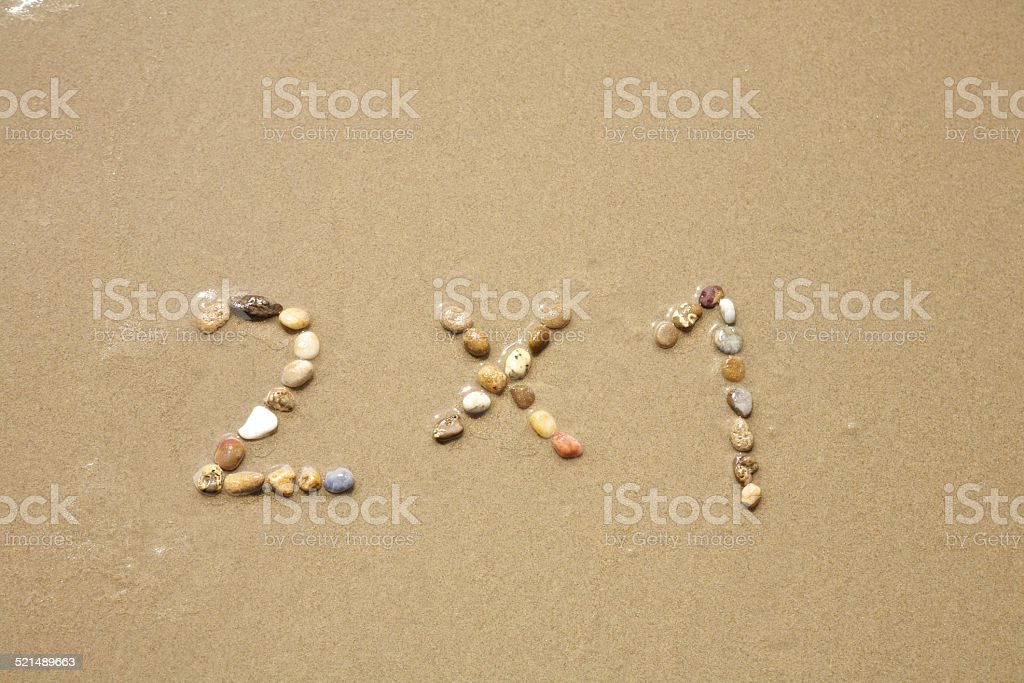 two for one stones on sand beach stock photo