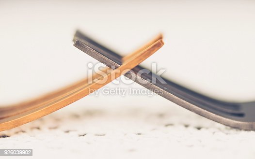 istock Two forks interlocked to portray the concept of conflict 926039902