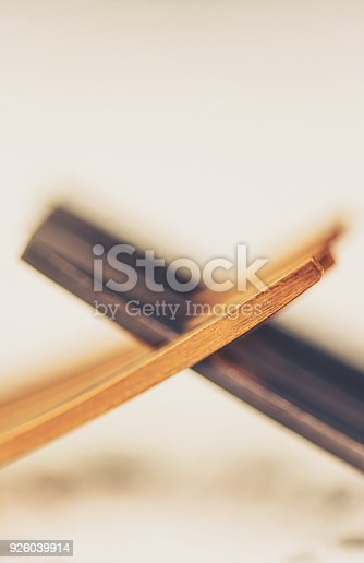 istock Two forks interlocked to portray the concept of conflict 926039914