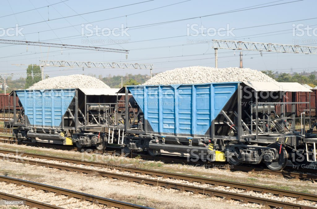 Two freight wagons with gravel on the siding on station stock photo