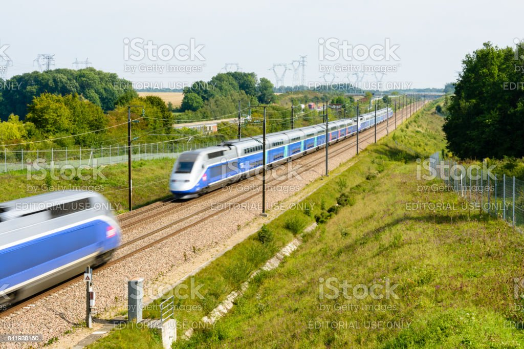Two french double-decker high-speed TGV Duplex trains crossing on the Paris-Lyon high-speed line stock photo