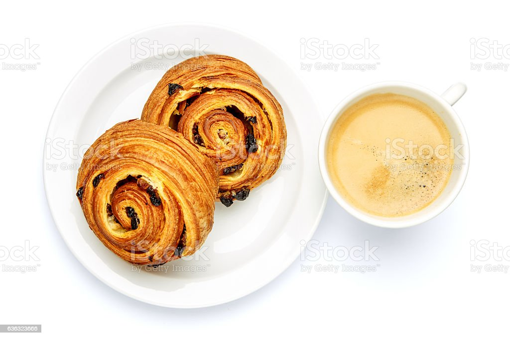 two fresh cinnabones and coffee on white background stock photo