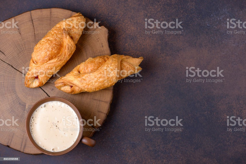 Two fresh croissants and coffee cup stock photo