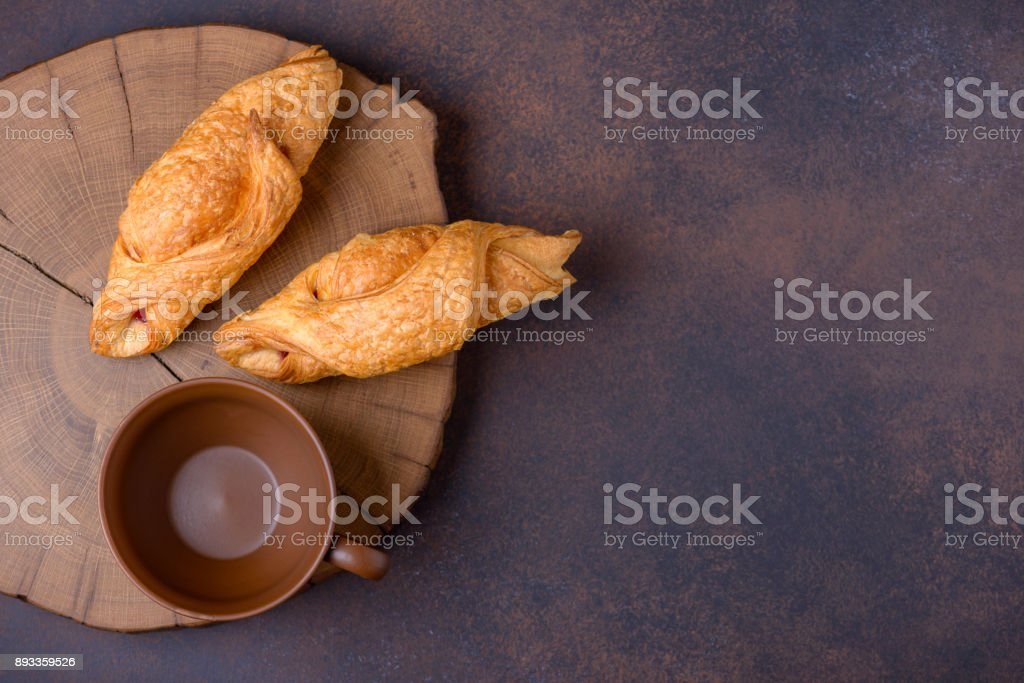 Two fresh croissants and empty cup stock photo
