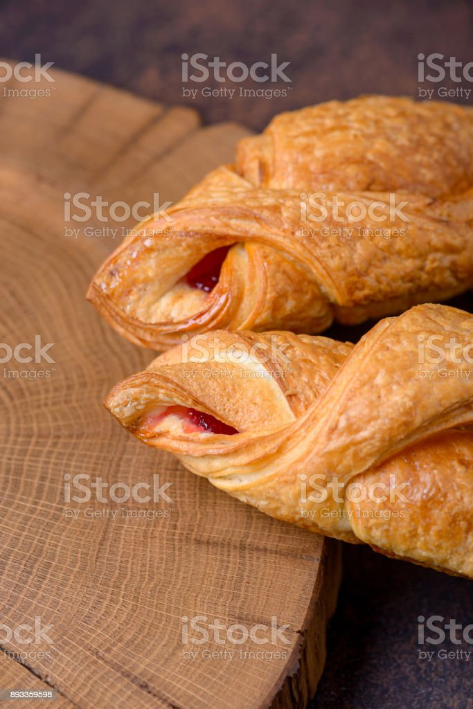 Two fresh croissants on cutting board stock photo