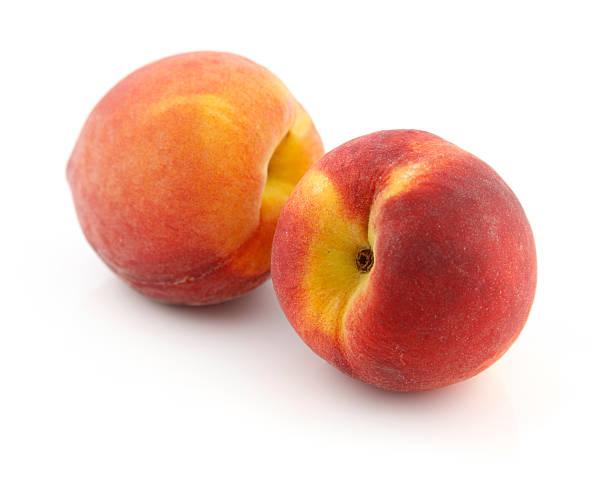 zwei frische pfirsiche - peach stock-fotos und bilder