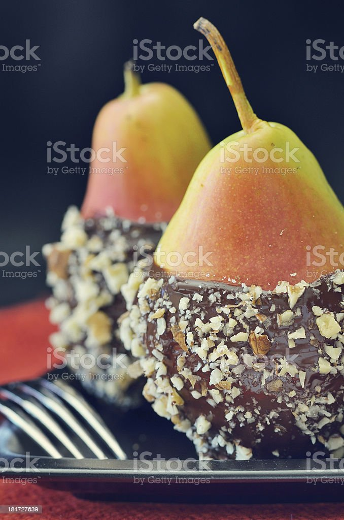 two fresh pear with chocolate icing royalty-free stock photo