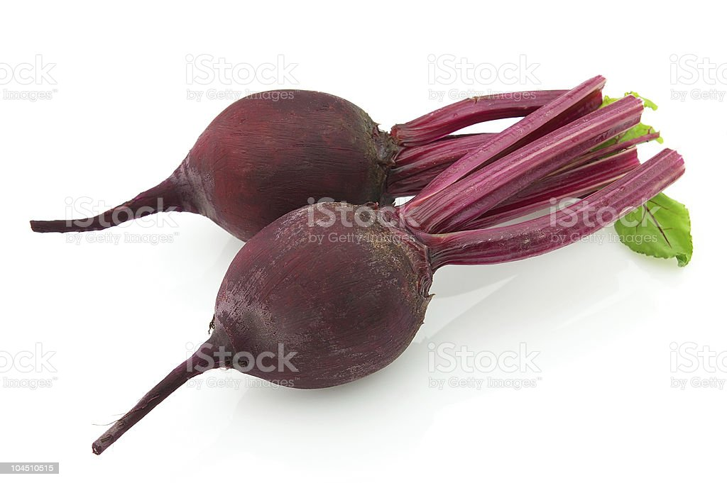 Two fresh purple beets on a white background royalty-free stock photo