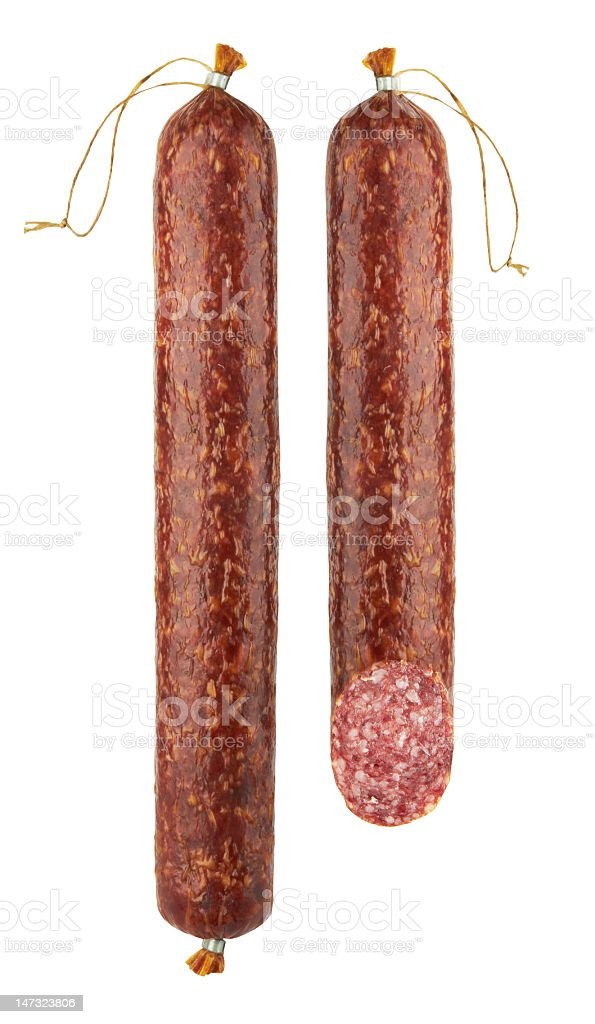 Two fresh salami hanging on a white background stock photo