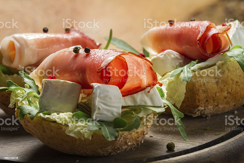 Two fresh sandwiches made of parma ham and brie cheese royalty-free stock photo