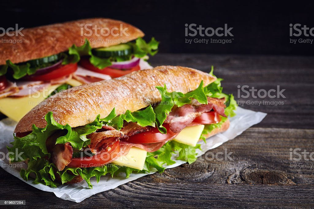 Two fresh submarine sandwiches stock photo