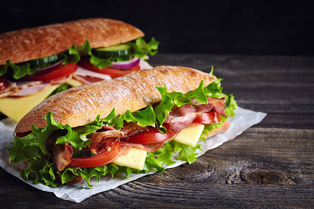 two fresh submarine sandwiches - delicatessen - fotografias e filmes do acervo