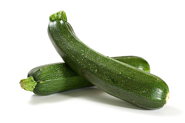two fresh zucchini isolated stock photo