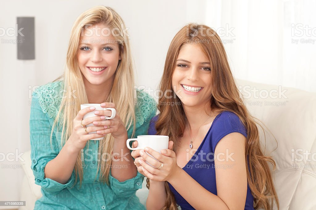 Two friend girls drinking coffee. royalty-free stock photo