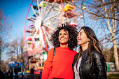 istock Two friends at the amusement park 1134747798