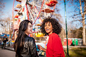 istock Two friends at the amusement park 1134747994