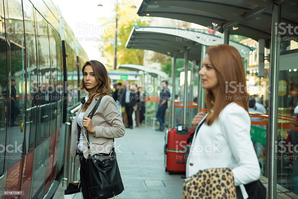 Two Friends At The Tram Stop stock photo