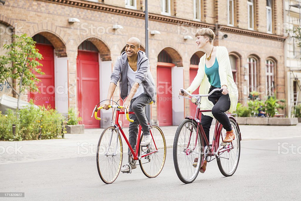 Two Friends Cycling in Berlin, Germany royalty-free stock photo