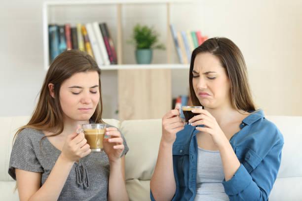 två vänner dricka kaffe med dålig smak - coffe with death bildbanksfoton och bilder