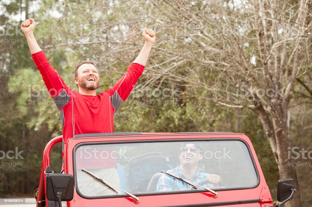 Two male friends hit the open road in their 4x4 vehicle for an...