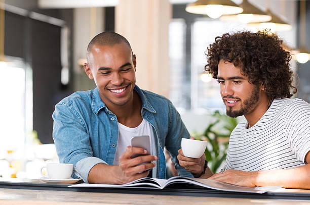 Two friends enjoying coffee stock photo