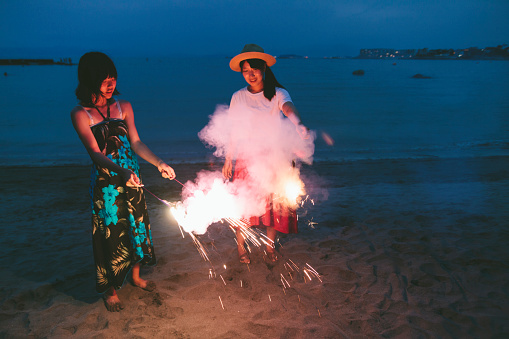 471113366 istock photo Two Friends Enjoying Fireworks 953727900