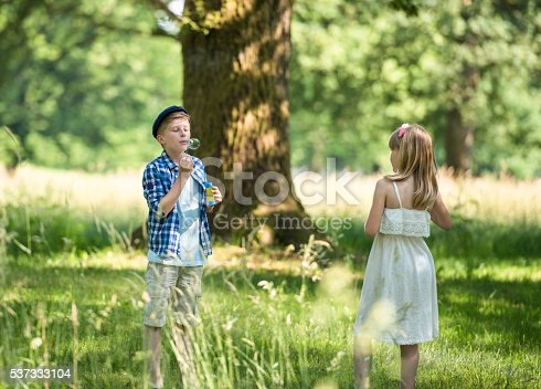 istock Two Friends Having Fun With Bubbles 537333104