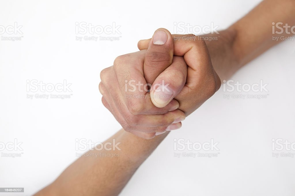 Two friends holding hands on a white background royalty-free stock photo