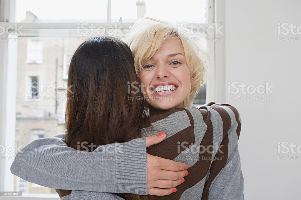 Two friends hugging royalty-free stock photo