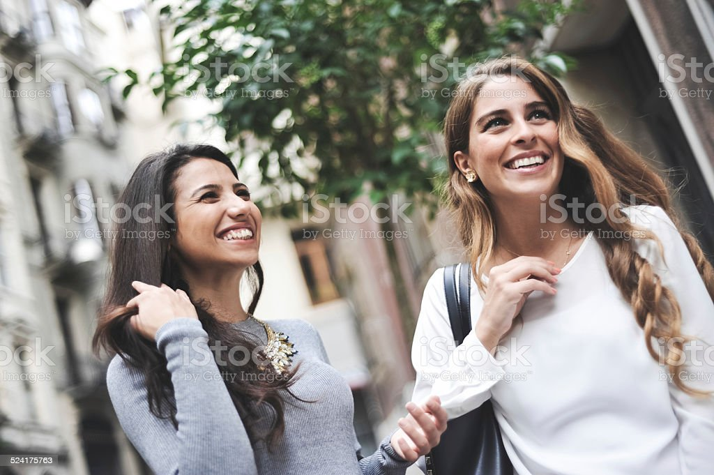 two friends laughing and talking royalty-free stock photo
