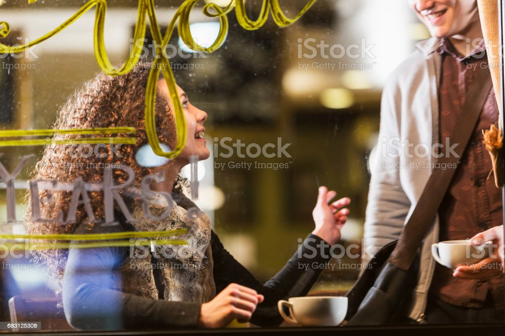 Two friends meeting for cup of coffee stock photo