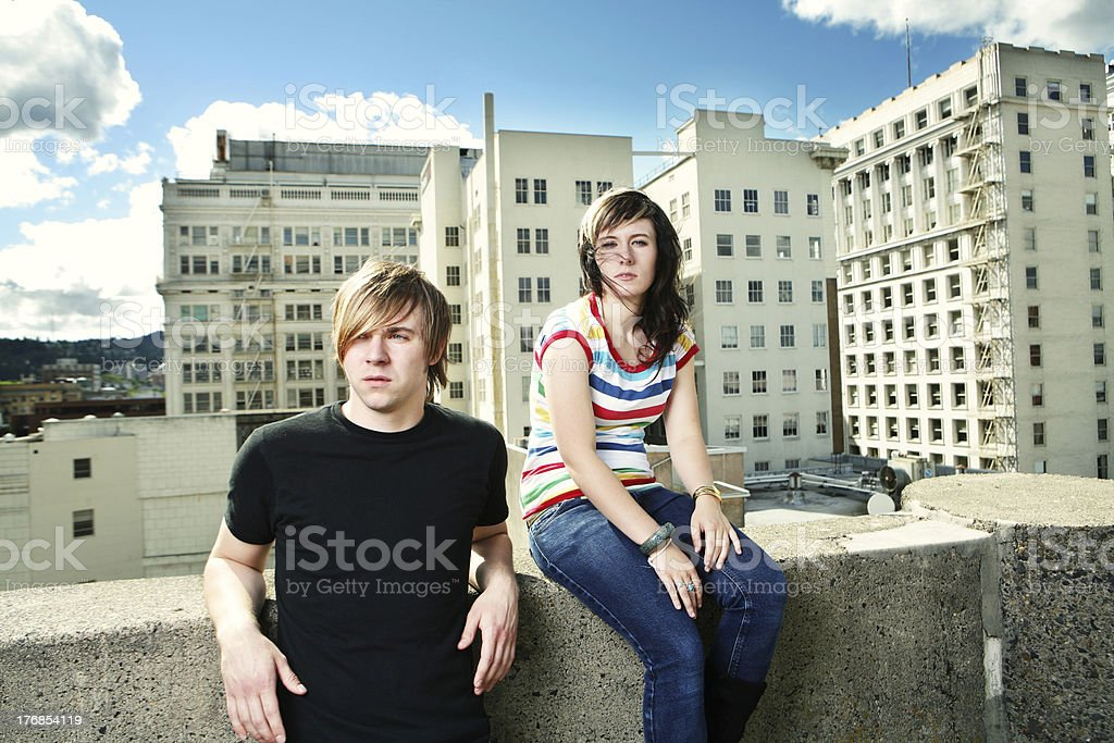 Two Friends on a Windy Rooftop royalty-free stock photo