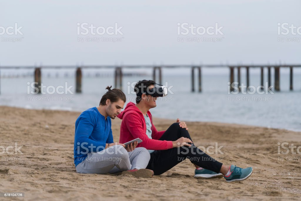 Two homosexual dudes playing on the beach