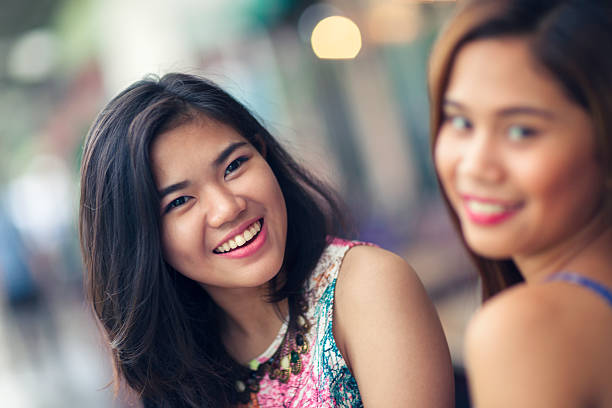 two friends out having fun - philippines girl stock photos and pictures