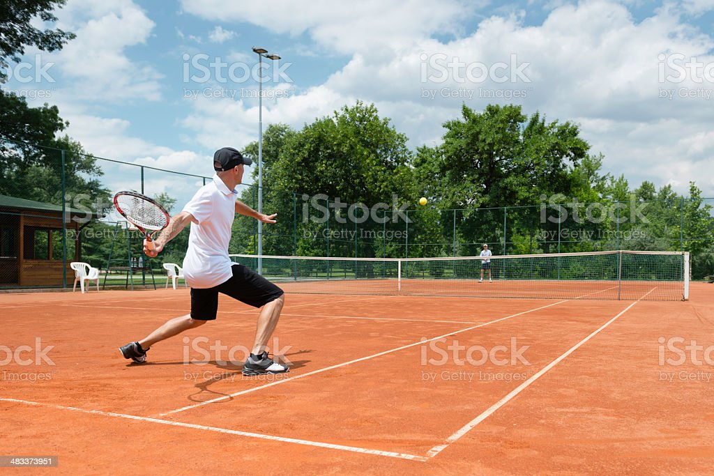 Two friends playing tennis royalty-free stock photo