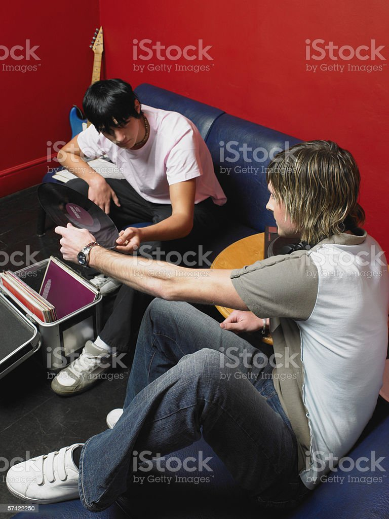 Two friends playing vinyl records royalty-free stock photo